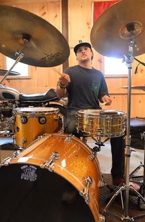 BRYAN EATON/ Staff Photo. Cold Engines Drummer Aaron Zaroulis.