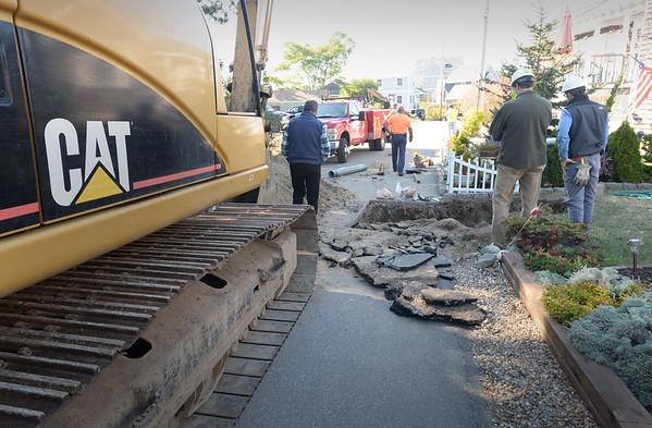 BRYAN EATON/ Staff Photo. Work has begun on repairing the fire hydrants on Plum Island, here on Columbia Way.