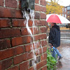 BRYAN EATON/ Staff Photo. Rain pours out of a downspout at the corner of State and Liberty Streets in Newburyport during Thursdays downpours.