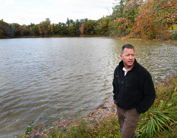 BRYAN EATON/Staff photo. Tom Cusick and his neighbors around Bailey's Pond in Amesbury are concerned about the muddy color of the pond which is near Beacon Street and Pleasant Valley Road.