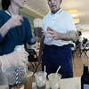 RYAN EATON/Staff photo. Newburyport Council on Aging activities coordinator Mary Kelly hands Donald Quantrail a root beer float on Wednesday. There were celebration their first anniversary of the Newburyport Senior Center's opening.