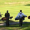 JIM VAIKNORAS/staff photo Pentucket's Sam Journeay, Newburyport's Ethan Coir, Triton's Sam Aponas, and Amesbury's Max Boland walk down the 3rd fairway at Old Newbury during River Rivals Golf Tournament.
