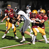 JIM VAIKNORAS/Staff photo Triton'sChristian O'Brien fights for a 2 point conversion at Newburyport Friday night.