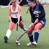 BRYAN EATON/Staff photo. Amesbury's Madeline Sartori and Hamilton-Wenham's #13 try for control of the ball.