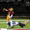 JIM VAIKNORAS/Staff photo Triton's Jack McCarthy sacks Newburyport QB Jack Cahalane  at Newburyport Friday night.