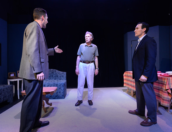 BRYAN EATON/Staff photo. Alan Huisman as Bill the father is confronted by Josh Paradis as Winky, left, and Will Poli as Scott, right.