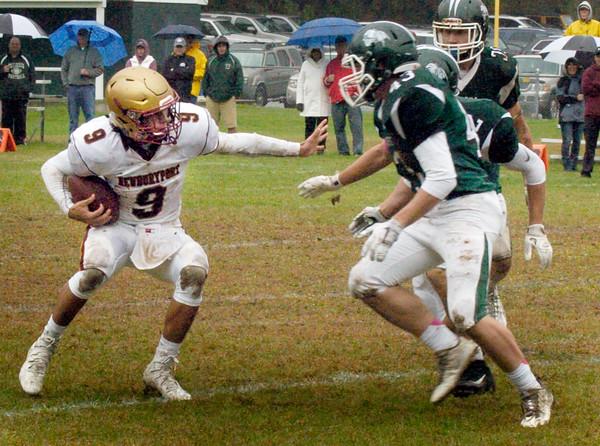 BRYAN EATON/Staff photo. Newburyport's Myles Maloof runs into some Pentucket defense.