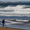 JIM VAIKNORAS/staff photo A treasure seeker uses a metal detector along the surf line as wave pound salisbury Beach Monday afternoon.
