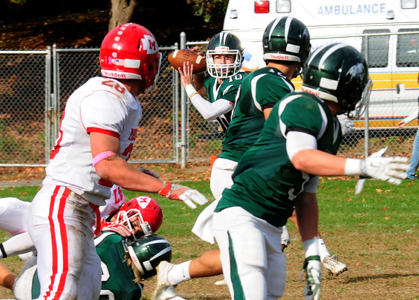 JIM VAIKNORAS/STAFF photo Pentucket Finn Graham looks for a reciever against Masco at Pentucket Saturday.