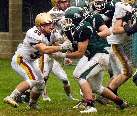 BRYAN EATON/Staff photo. Newburyport's Ryan Tamayoshi, left, playing defense.