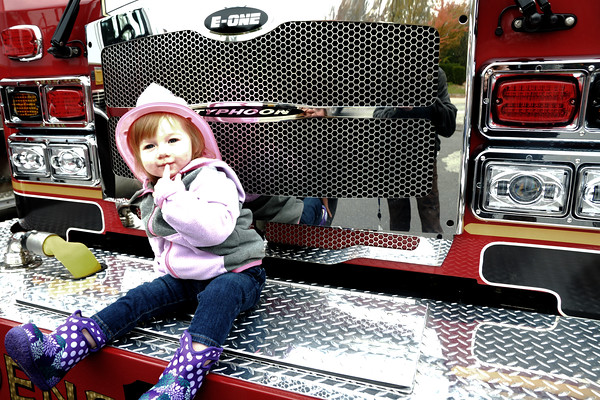 JIM VAIKNORAS/Staff photo Madilyn Sargent, almost 2, wears a pink firefighters hat as she checks out on of the trucks at the Salisbury Fire Station Open House
