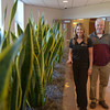 JIM VAIKNORAS/Staff photo Lisa Petty of Plantwerks stands with Newburyport high Principal Michael Parent with plants donated by Plantwerks at the entrance way to the high school.