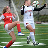 BRYAN EATON/Staff photo. Masco's Athena Kordis kneed the ball past Newburyport's Cricket Good.