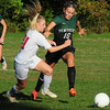 JIM VAIKNORAS/Staff photo Amesbury's Hanaih Burdick and Pentucket's Ellison Seymore fight for the ball during their game at the Cashman School in Amesbury.