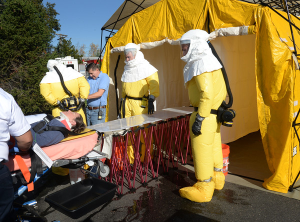 BRYAN EATON/Staff photo. Area rescue personnel set up a decontamination tent outside Anna Jaques Hospital in a drill where people were affected by a chemical leak.