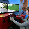 BRYAN EATON/Staff photo. Amesbury High School student Jennifer Magowan, 17, takes a Distractology course sponsored by Gould Insurance. Two students at a time take the course in a large mobile unit that teaches the students the importance of not being distracted by cell phone use or any other means of not paying attention to the road.