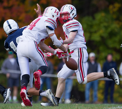 Jared Charney / Photo Amesbury's Cameron Leary breaks up a pass intended for Hamilton-Wenham's Ian Coffey at the end of the first half at Hamilton-Wenham High School, Saturday, October 15, 2016.