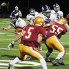 JIM VAIKNORAS/Staff photo Triton's Bryan Hughes runs behind good blocking  at Newburyport Friday night.