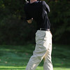 JIM VAIKNORAS/staff photo North Reading's Joey Fitzgerald tees off at the CAL open golf at Far Corners.