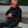 JIM VAIKNORAS/Staff photo Warm autunm light catches guitar player Joe Casey of Newburyport as he strums a tune on the boardwalk in Newburyport Wednesday afternoon.