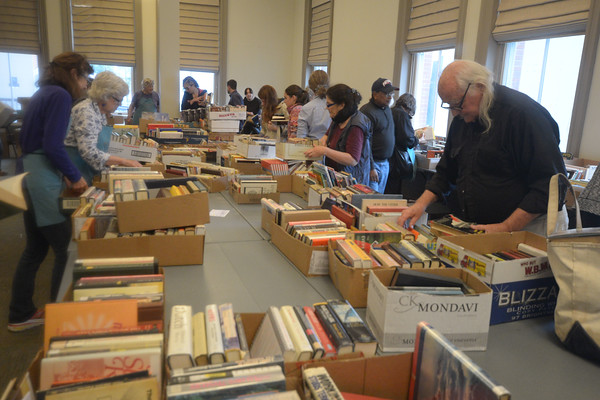 JIM VAIKNORAS/Staff photo Book lovers make a final search for bargins at the annual Book sale at Newburyport Library Saturday afternoon.