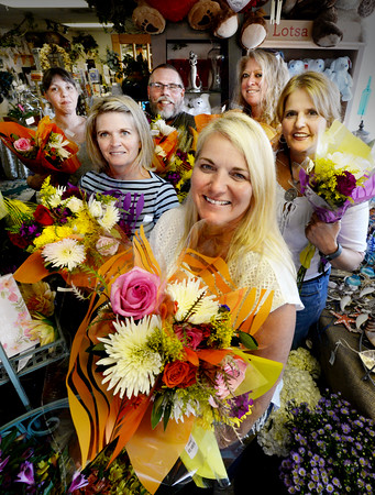 BRYAN EATON/Staff photo. Marianne Velardocchia, front, and her crew from her Seabrook flower shop will be handing out over 400 bouquets of flowers to two hundred people tomorrow as part of the Petal It Forward campaign. Clockwise from Velardocchia are Claire Taddeo, Michele Amodie, Ron Adkins, Christi Gynan and Faith Chartrand.