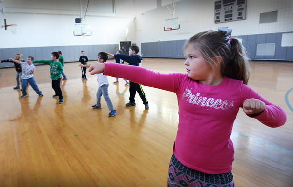 BRYAN EATON/Staff photo. 10/24/16 Olivia Eaton, 7, takes a karate stance at Salisbury Elementary School yesterday afternoon. She was in the afterschool program Explorations taking lessons from Jenna Poulin.