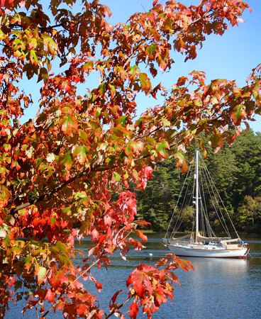 BRYAN EATON/Staff photo. Leaves are continuing to turn colors and boats that are in the water, here on Pleasant Valley Road in Amesbury on the Merrimack River, will be coming out of the water in the coming days. The weather will warm heading into the weekend though rain from Hurricane Matthew could affect the area at the end of the weekend.