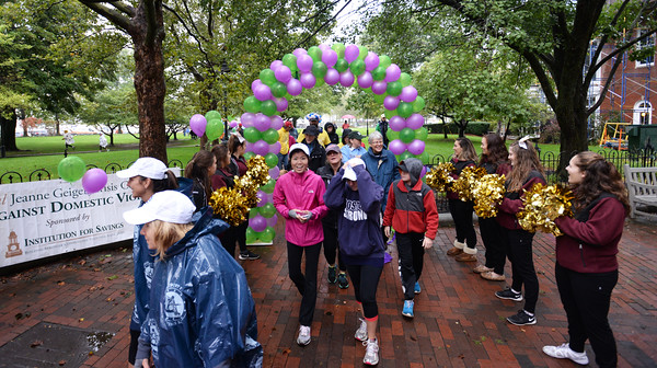 BRYAN EATON/Staff photo. A little drizzle didn't put a damper on the 25th Walk Against Domestic Violence as participants started the walk through an entrance of balloons past the Newburyport High School football cheerleaders. The walk hosted by the Jeanne Geiger Crisis Center is one of their largest fundraisers allowing to fund various support services.