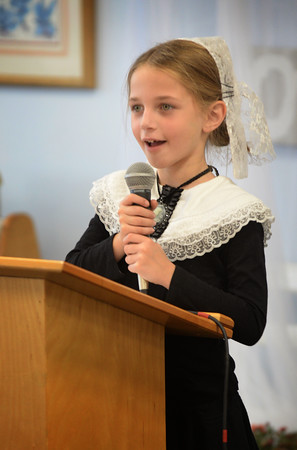 """BRYAN EATON/Staff photo. Isabella Roccograndi, 6, portrays Elizabeth Blackwell, the first woman doctor in the United States at """"HIstory Mystery"""" at the River Valley Charter School in Newburyport. The children read a biography of the person they studied with the audience, of fellow students and parents, trying to quess who the person was."""