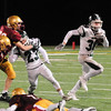 JIM VAIKNORAS/Staff photo Pentucket's Liam Sheehey turns the corner on a run at Newburyport Friday night.