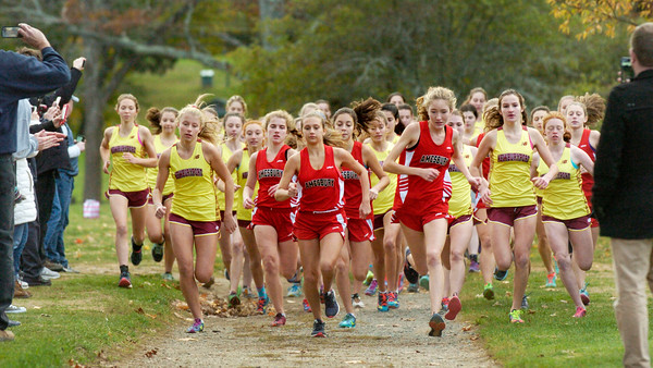BRYAN EATON/Staff photo. Amesbury and Newburyport girls runners head out on the course.