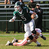 JIM VAIKNORAS/STAFF photo Pentucket's Steve Johanson breaks a tackle against Masco at Pentucket Saturday.