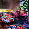 BRYAN EATON/Staff photo. Charlotte Moore, 4, of Amesbury has a tough decision of what candy to choose outside the Newburyport Five Cents Savings Bank in downtown Amesbury last night. She was participating in the Amesbury Chamber of Commerce and Industry's annual Downtown Trick or Treat.
