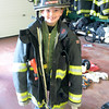 JIM VAIKNORAS/Staff photo Brody Powers, 6, tries on fire fighters turnout gear at the Salisbury Fire Station Open house Saturday.