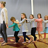BRYAN EATON/Staff photo. Newburyport High School junior Stephanie Webster, 16, leads youngsters in dance at the Bresnahan School on Wednesday afternoon. It was the second week of dance lessons in the afterschool enrichment program sponsored by the school's PTO.