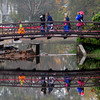 JIM VAIKNORAS/Staff photo The costume parade is reflected in the pond at Amesbury Park as it crosses the bridge during the Fall Festival Saturday ,along with the parade kids and grownup also enjoyed a costume contest, crafts games, music and a pie eating contest