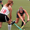 BRYAN EATON/Staff photo. Hamilton-Wenham's #18 tries to get the ball from Amesbury mid-fielder Lydia Pinette.