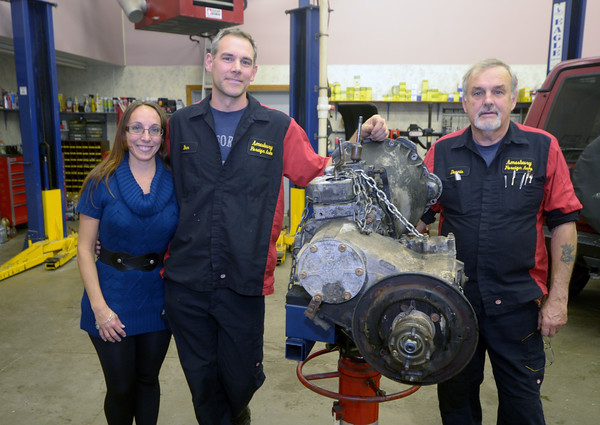 JIM VAIKNORAS/Staff photo Owners Arianna and  Ben Tallberg and former owner Dennis Gagnon at Amesbury Foreign Motors.