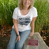 "JIM VAIKNORAS/Staff photo Sally Leety sits on a stone baring a plaque dedicated to her at the entrance way to the Nock Middle School. Leety is retiring after 34 years teaching social studies, the plaque reads "" A tribute to our teacher, our civic hero, Sally Leety. ""Each time a man stands up for an ideal, or acts to improve the lot of others, or strikes out against injustice, he sends forth a tiny ripple of hope""<br /> R F Kennedy."
