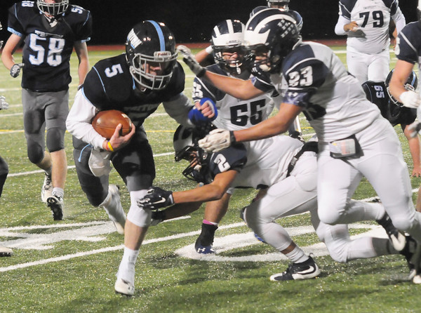 JIM VAIKNORAS/Staff photo Triton's Liam Splillane breaks a tackle against Swampscott at Triton.