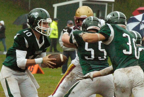 BRYAN EATON/Staff photo. Pentucket quarterback Finn Graham hands off to running back Liam Sheehy.