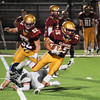 JIM VAIKNORAS/Staff photo Newburyport's Donte Harmon breaks a tackle at home against Triton friday nigt.