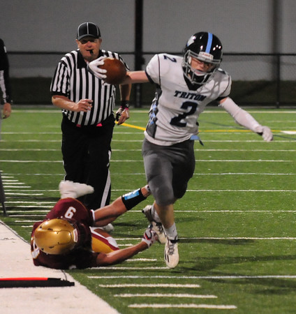 JIM VAIKNORAS/Staff photo Triton's Tom Lapham tries to stay in bounds on a play at Newburyport Friday night.