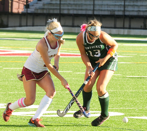 JIM VAIKNORAS/Staff photo Newburyport's Olivia Thirkell fights for the ball with Pentcuket's Jenna Fiore during their game at Newburyport. The Clippers won the game 2-0.