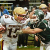 BRYAN EATON/Staff photo. Pentucket's #53 grabs onto Newburyport's Donte Harmon who broke free for the touchdown.