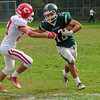 JIM VAIKNORAS/Staff photo Pentucket's Robert Porter stiff arms Masco's Owen Denn during their game at Pentucket Saturday.