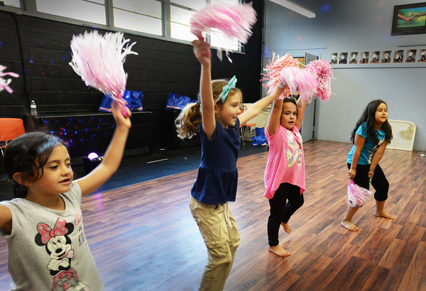 BRYAN EATON/Staff photo. Youngsters in Sam Stanton's dance class at the Boys and Girls Club use pom poms in a routine during practice on Monday. The Believers and The Maple Street Boys in the class are preparing for a show on December 11.