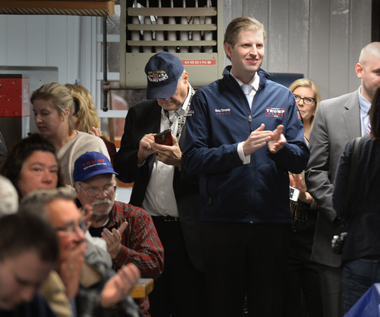 BRYAN EATON/Staff photo. Eric Trump applauds former New Hampshire governor John Sununu before speaking to a crowd of around 200.