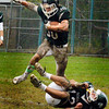 BRYAN EATON/Staff photo. Pentucket's Liam Sheehy goes for some yards towards Newburyport turf.
